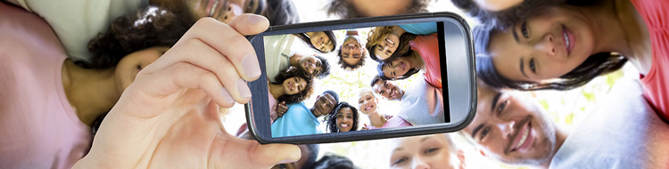 group of people in a huddle taking a selfie